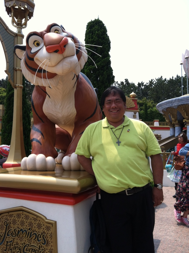 Standing next to Rajah about to ride Jasmine's Flying Carpets
