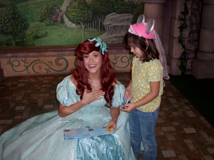 Ariel having just read the inscription in the autograph book
