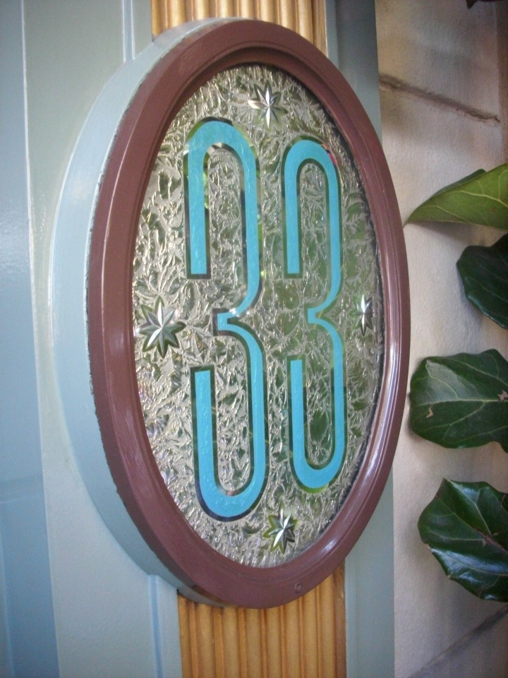 "The iconic ""33"" address in New Orleans Square hides an exclusive supper club behind its doors."