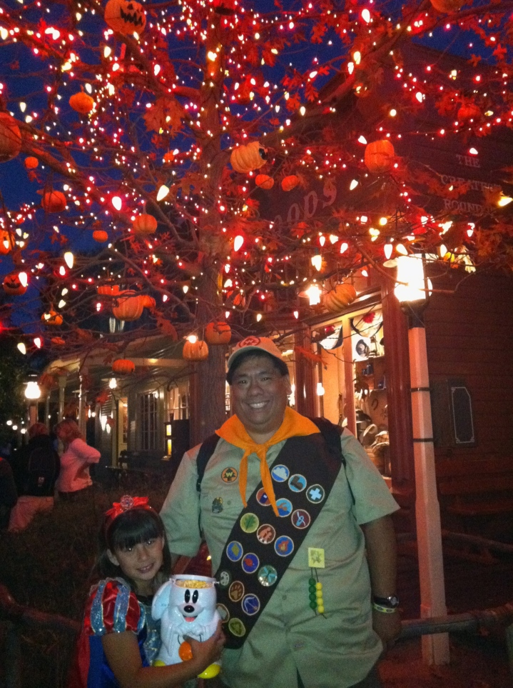 At night in front of the Halloween Tree with our Mickey Ghost Popcorn