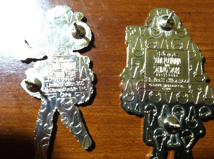 On the left, a fake pin and on the right a genuine one.  Notice the differences?