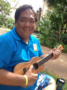 Learning to play the ukelele at a free class at the resort