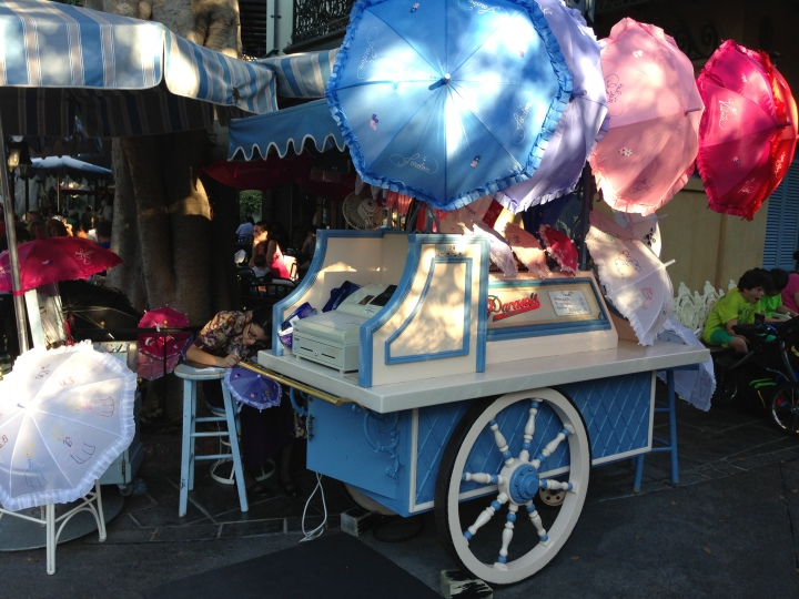 The parasol cart standing unobtrusively in New Orleans Square