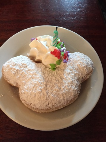 Celebrating a birthday? Get a Mickey beignet all decked out for the birthday gal (or guy)