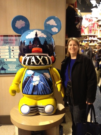 My wife Cassie standing next to a life-sized Vinylmation figure exclusive to NYC Disney Store
