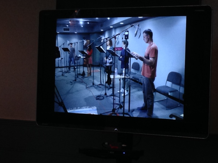 Images of the cast recording together in the studio