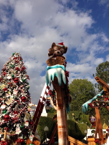 Duffy waving high from on top during the Christmas Fantasy Parade
