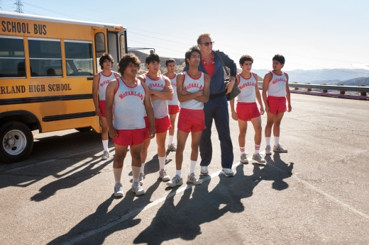 McFARLAND, USA..L to R: Jose Cardenas (Johnny Ortiz), Danny Diaz (Ramiro Rodriguez), Thomas Valles (Carlos Pratts), Victor Puentes (Sergio Avelar), Damacio Diaz (Michael Aguero), Coach Jim White (Kevin Costner), Johnny Sameniego (Hector Duran) and David Diaz (Rafael Martinez)..Ph: Ron Phillips courtesy of Disney 2015