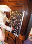 One of the pin boards manned by a footman dressed in elegant Cinderella style