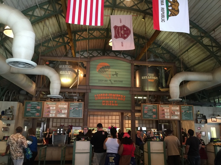 Formerly Taste Pilots Grill, the new building retains the high-ceiling look with a more national park theme