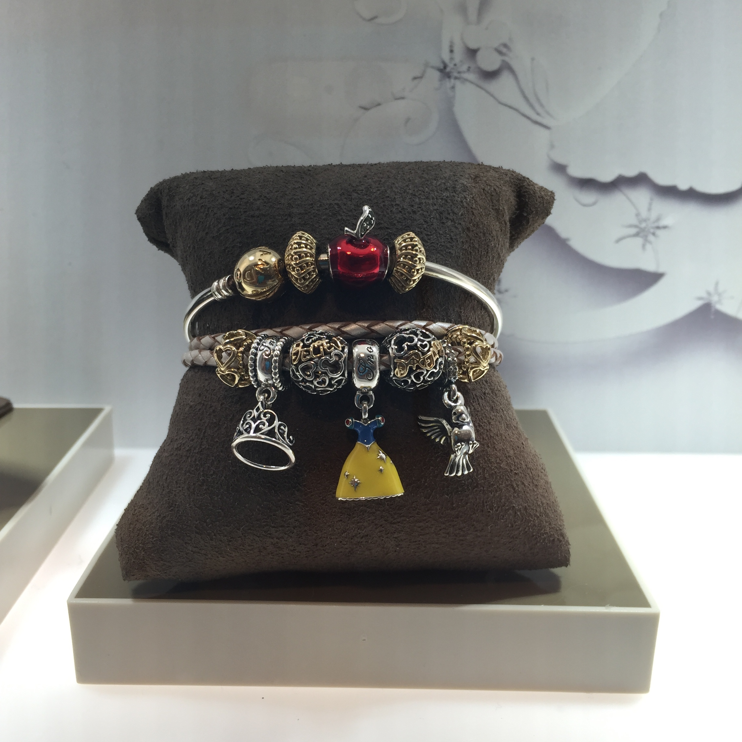 72c1956f0 Beautiful charm bracelet at a Pandora store featuring Snow White's dress