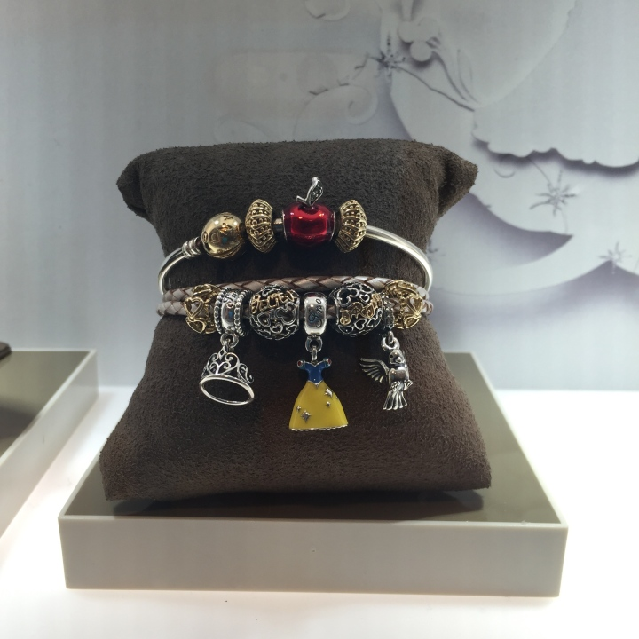 Beautiful charm bracelet at a Pandora store featuring Snow White's dress