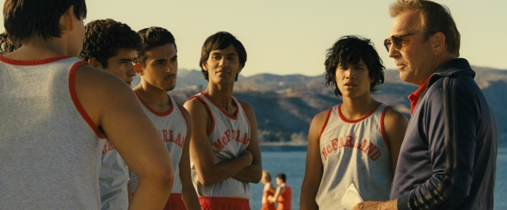 McFARLAND, USA..L to R: Johnny Sameniego (Hector Duran), Victor Puentes (Sergio Avelar), Damacio Diaz (Jamie Michael Aguero), Jose Cardenas (Johnny Ortiz) and Coach Jim White (Kevin Costner)..Ph: Film Frame..Courtesy of Disney 2015