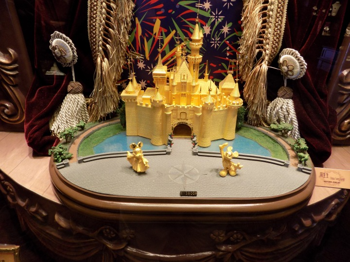 Beautiful gold castle with gold Mickey and Minnie will only set you back about $80,000 USD