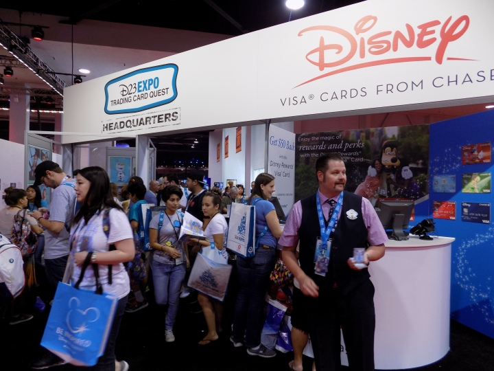 A crazy zoo of people collecting the Disney VISA trading cards