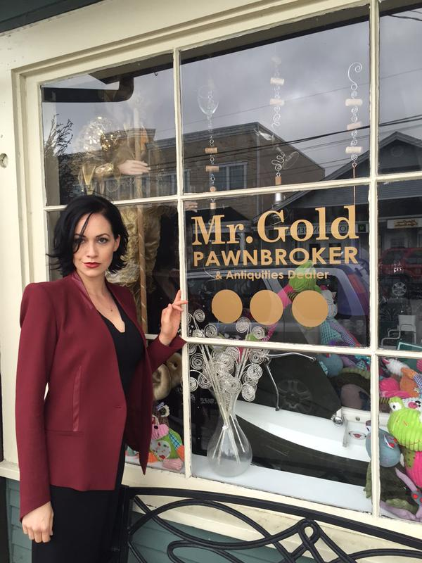 Reini in front of Mr. Gold's pawn shop in the real town of Steveston Village in British Columbia, Canada