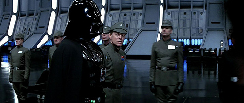 Moff Jerjerrod speaks to Lord Vader hoping not to feel the Dark Lord's wrath