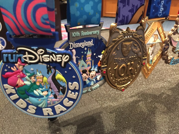 The different medals on display at the runDisney booth