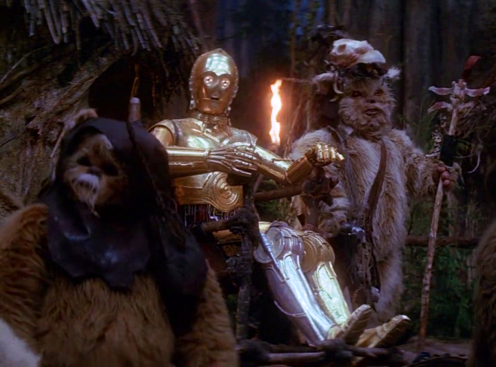 Ewoks worship C3PO and are about to cook a feast in his honor - composed of Han, Luke, and Chewie!