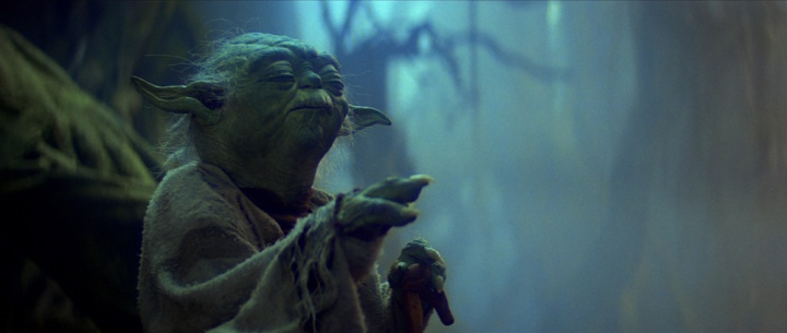 Yoda using the Force to lift Luke's X-wing out of the swamp