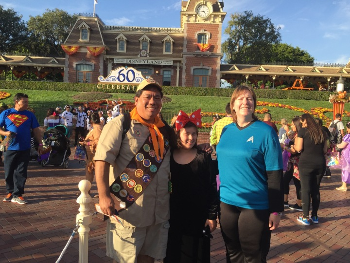 Our family at this year's Mickey's Halloween Party - (L to R) me as Russell from UP, Emma as Kiki from Kiki's Delivery Service, and Cassie as a science officer from Star Trek