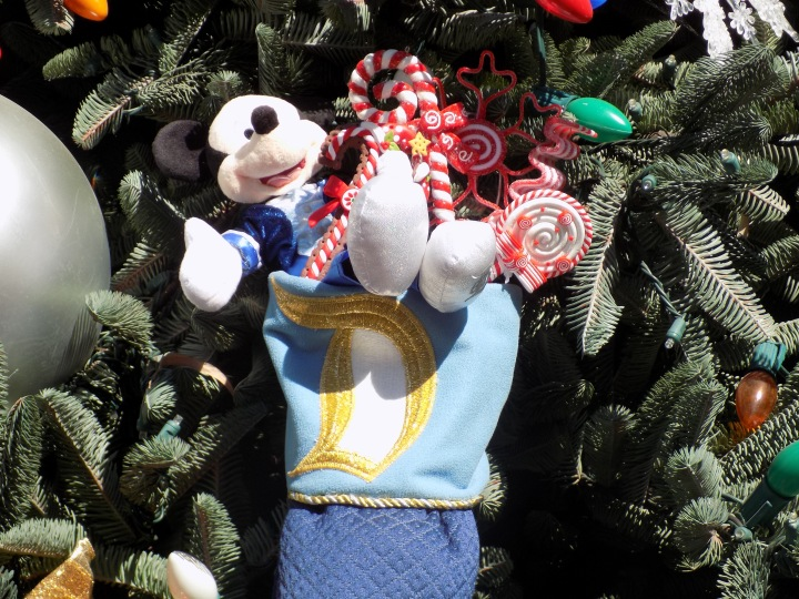 Stockings hanging from the tree with a Disneyland 60th theme