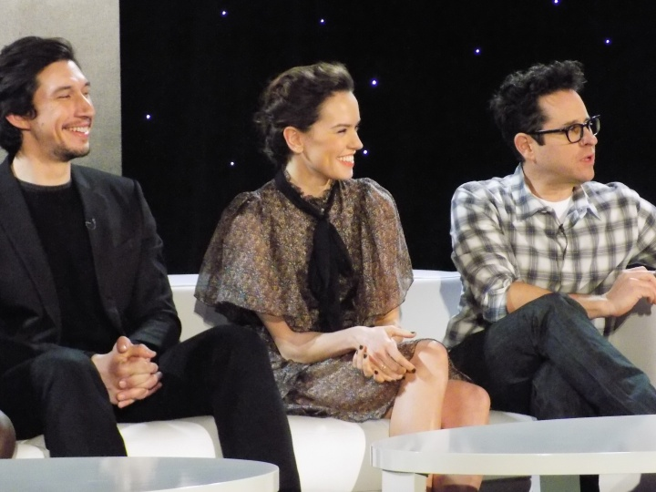Adam Driver, Daisy Ridley, and JJ Abrams sharing a good laugh