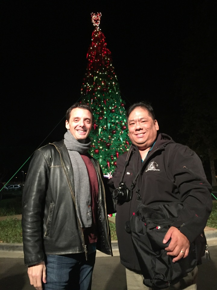 Standing in front of the Christmas tree with Jeffrey Epstein on the studio grounds
