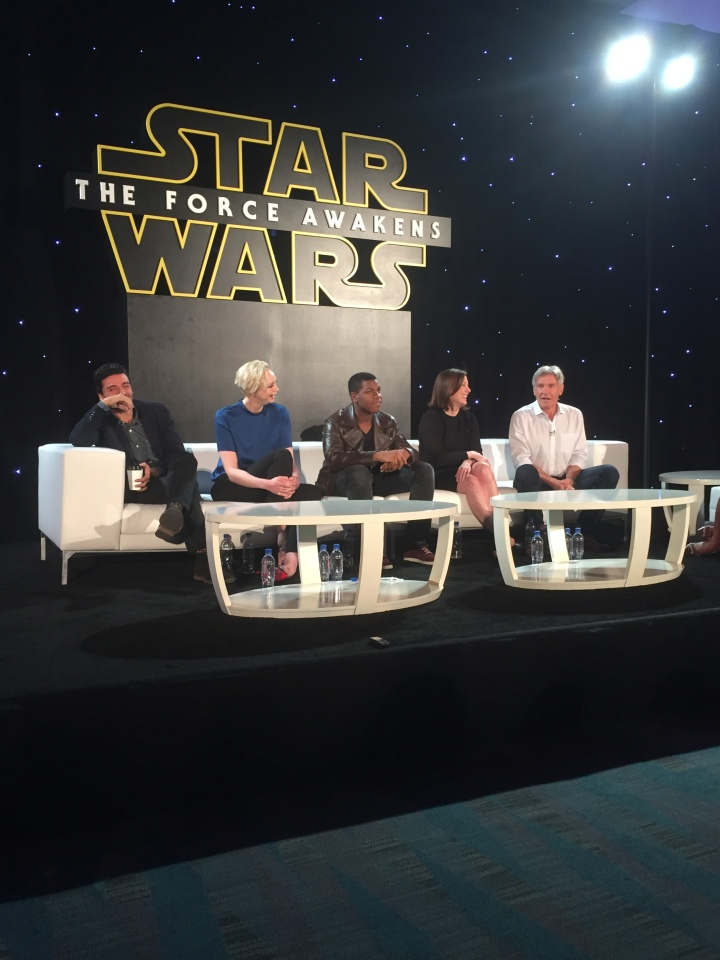 The cast of Star Wars: The Force Awakens sharing a laugh