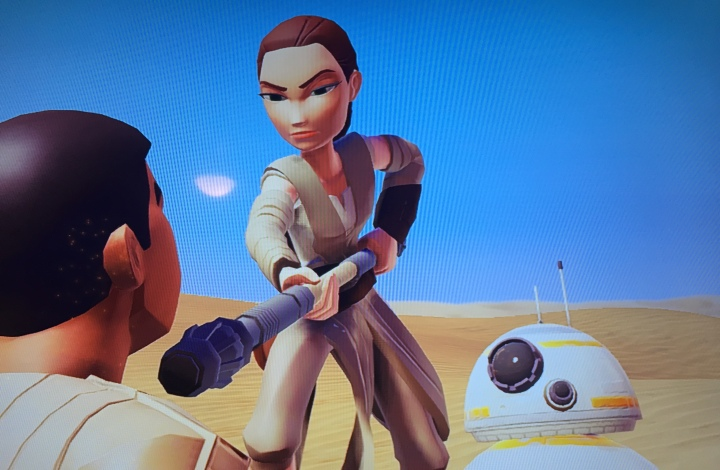 Actual screenshot of a cut scene in the game featuring Finn and Rey (and BB-8)