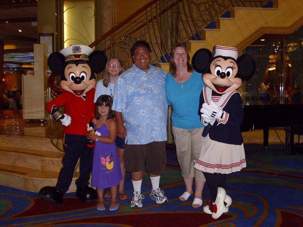 Family picture with Mickey and Minnie - one of MANY photo ops every day