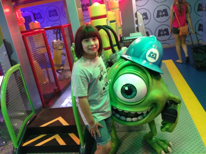 Taking a picture with Mike in the Monsters Inc area during parent open house - the one time you can go in with your kids