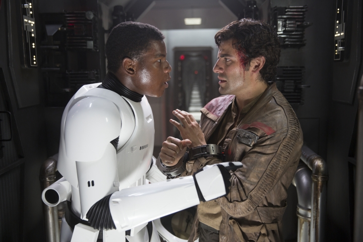 Star Wars: The Force Awakens..L to R: Finn (John Boyega) and Poe Dameron (Oscar Isaac) talk about escaping from the First Order Ph: David James..copyright 2015 Lucasfilm Ltd. TM. All Rights Reserved.
