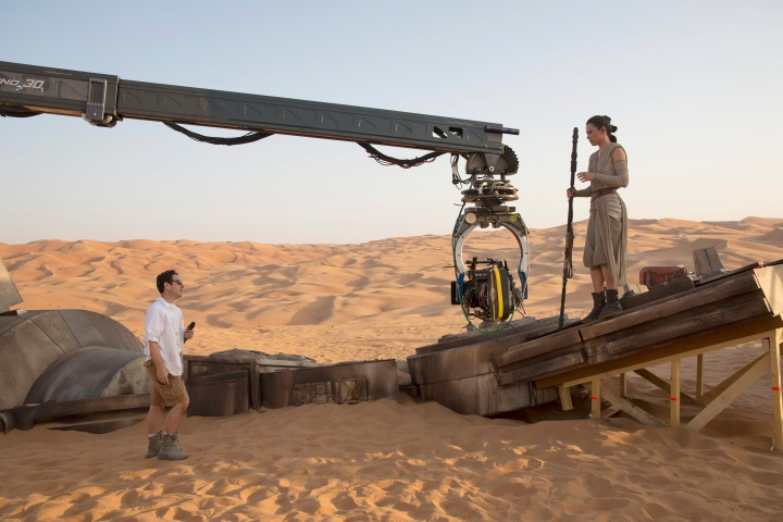 Star Wars: The Force Awakens..L to R: Director J.J. Abrams w/ actress Daisy Ridley (Rey) on set...Ph: David James..copyright 2015 Lucasfilm Ltd.; TM. All Right Reserved.