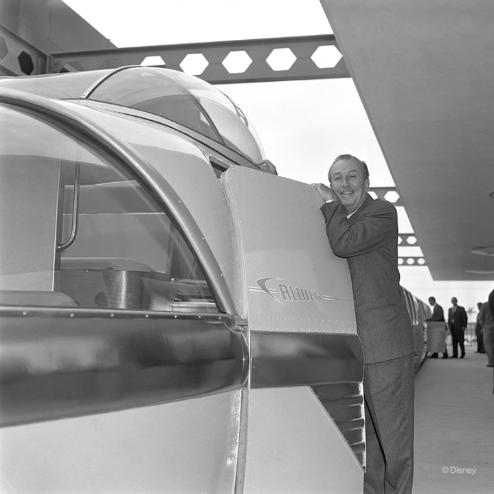 Walt Disney poses for a photo with the then-newly-minted Disneyland Monorail expansion in Spring 1961. The expanded attraction connected Disneyland® Park to the Disneyland Hotel, allowing Guests easy transportation from one location to the other.