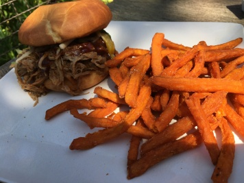 The Slow-Roasted Kalua-Style Pork Sandwich with sweet potato fries