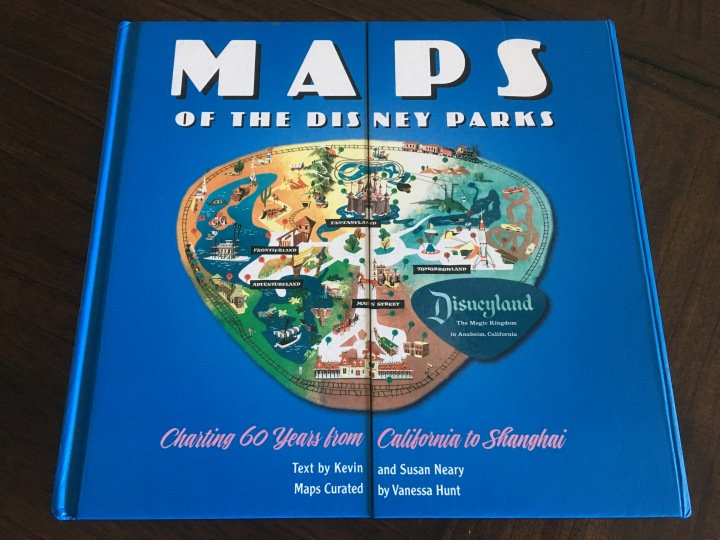 Cover artwork of Maps of the Disney Parks and yes, it opens up in the middle like you were unfolding a map