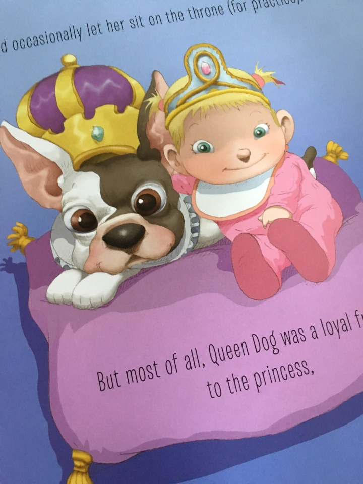 Queen Dog loves the newest princess to the land