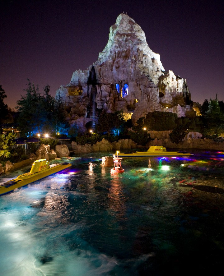 MATTERHORN BOBSLEDS AT NIGHT -- The first tubular steel roller coaster opened in 1959 at Disneyland adjacent to the Submarine Voyage Lagoon.  Guests on the Matterhorn Bobsleds scale the snowy summit in a racing toboggan and speed down the slopes to a sensational splashdown in an Apine pond, while the Abominable Snowman is rumored to be lurking around every turn.  (Paul Hiffmeyer/Disneyland)
