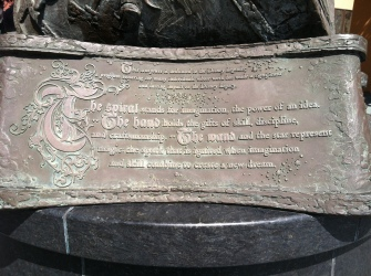 The words inscribed at the base of the statue