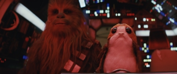 Star Wars: The Last Jedi..L to R: Chewbacca (Joonas Suotamo) and a Porg..Photo: Industrial Light & Magic/Lucasfilm..©2017 Lucasfilm Ltd. All Rights Reserved.