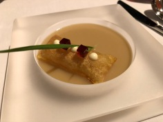 Yunan leek and truffle potato soup with souffle puff and beef jelly