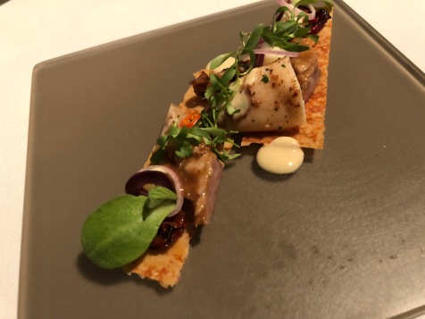 Mediterranean style mackerel fillet with baby calamari and new potatoes