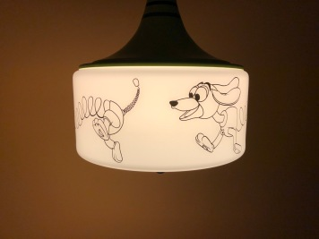 This lamp is so cute. I'd want a Slinky Dog lamp at home.