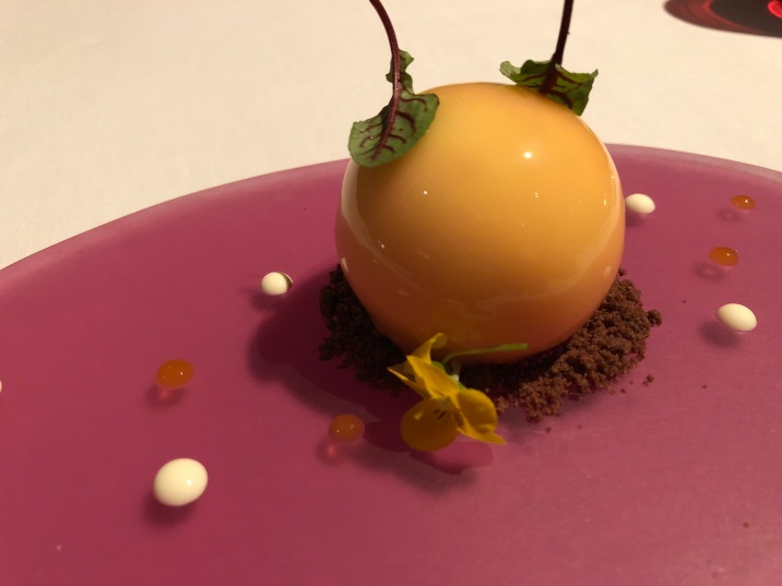 "The signature dessert at Aurora - a green tea cake shaped like a peach. Beautiful but not my cup of ""tea"""
