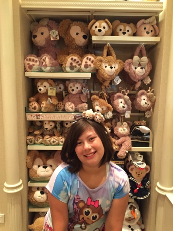 Emma at Hong Kong Disneyland Hotel and the wall of Duffy behind her