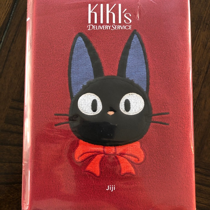 The Jiji Plush Journal is soft but not too soft. It's still definitely a book and easily goes on your shelf